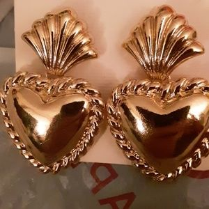 2 pairs post large gold tone heart earrings.